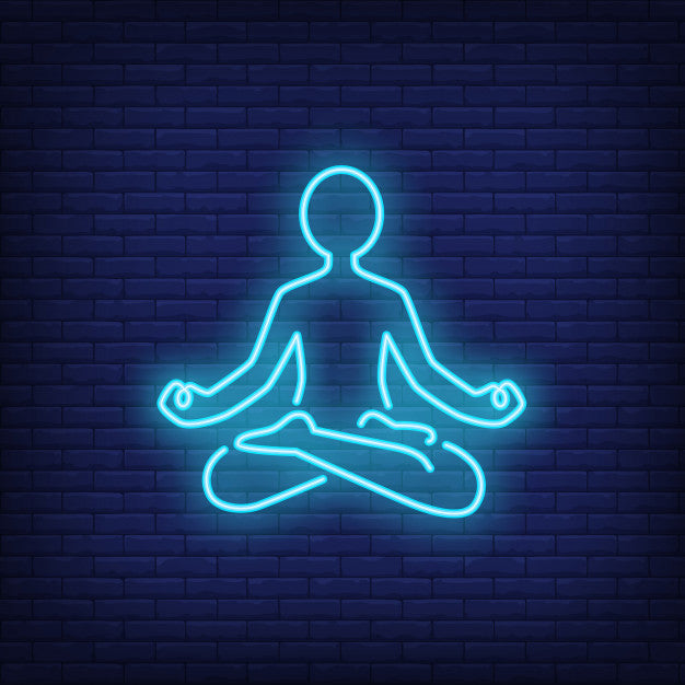 Person sitting in lotus pose and meditating neon sign