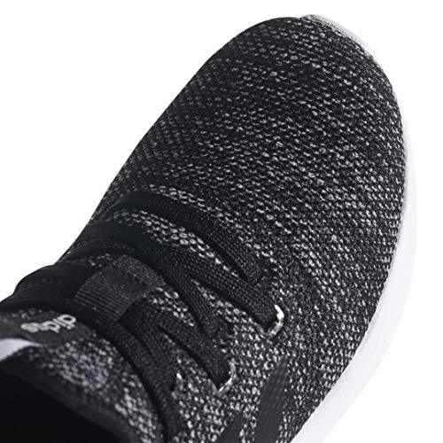 a close up of a black and black shoes