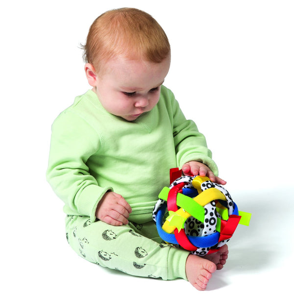 Why rotating toys helps develop your baby's ability to focus?
