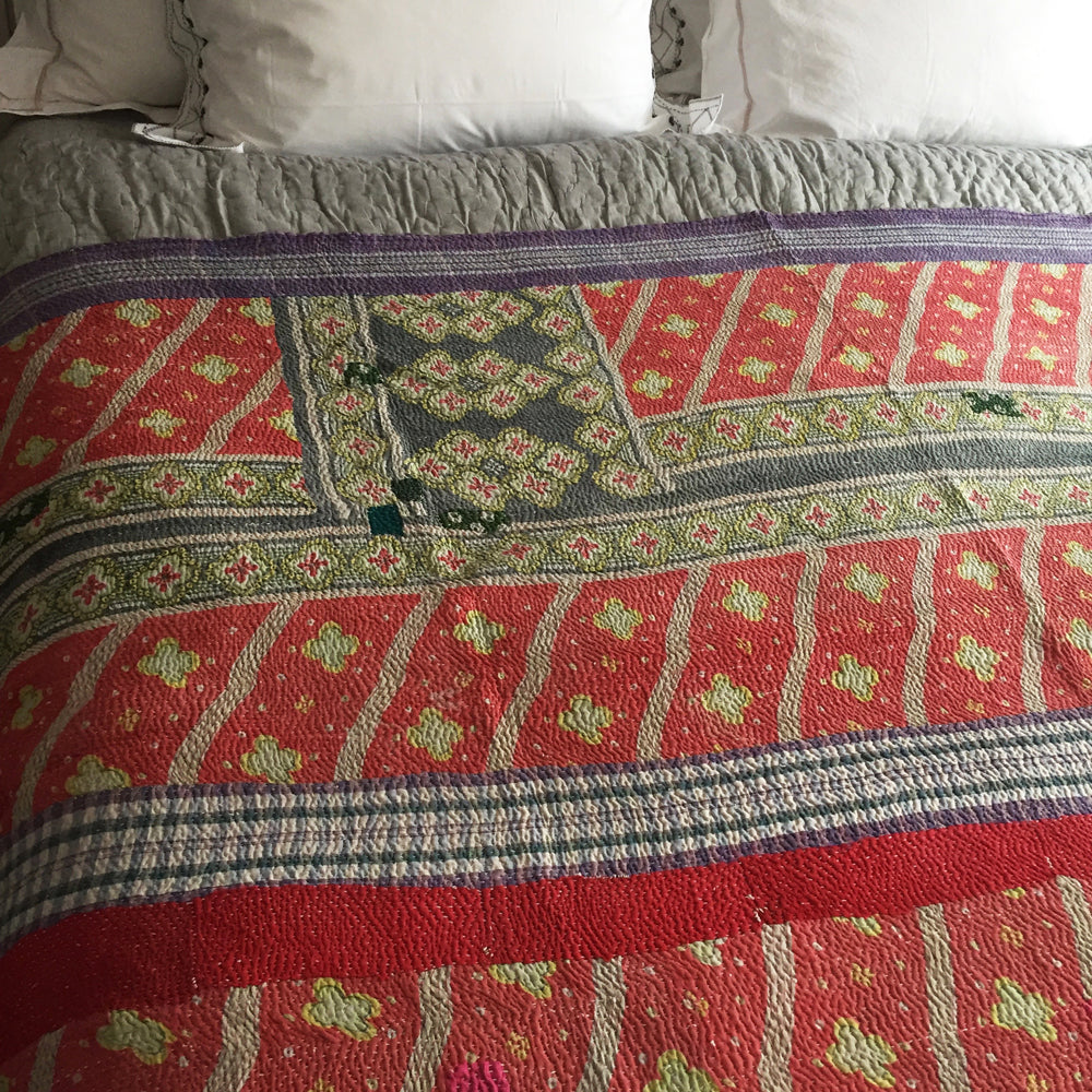 Faded red floral & blue check kantha quilt