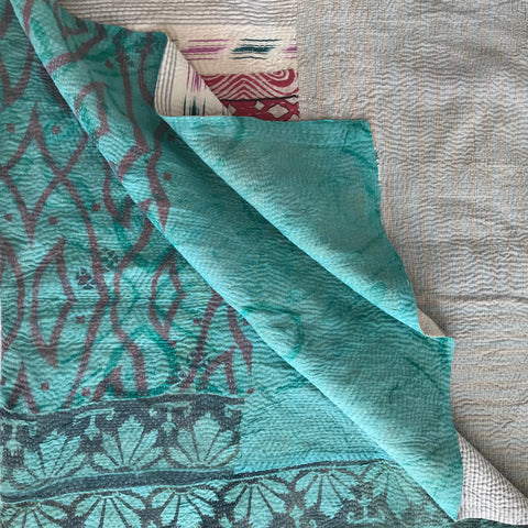 Turquoise Ikat & white check kantha quilt