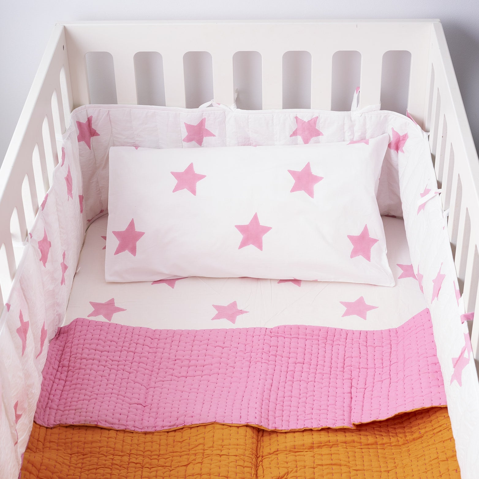 Pastel pink star cot bed bumper