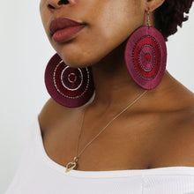burgundy and red handmade cotton statement earrings on model