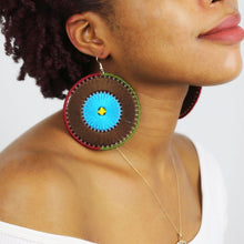 handmade multicolor statement earrings on model