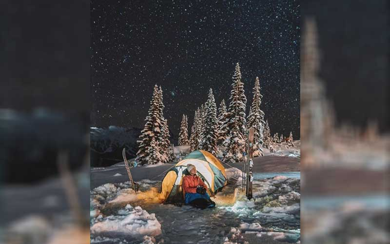 Person camping in snowy Whistler, Canada