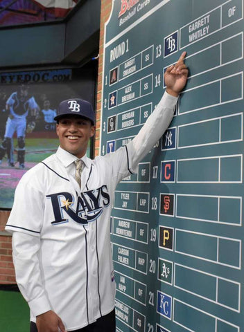 Garrett Whitley pointing to his name on a scoreboard