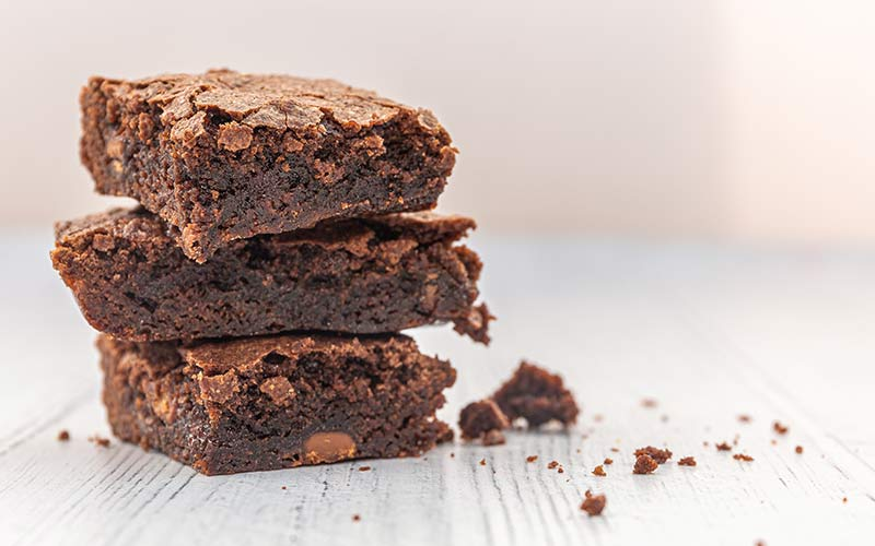 A stack of three brownies made with instant coffee.