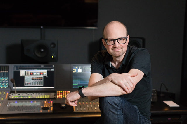 Brian Volk-Weiss in front of a mixing board