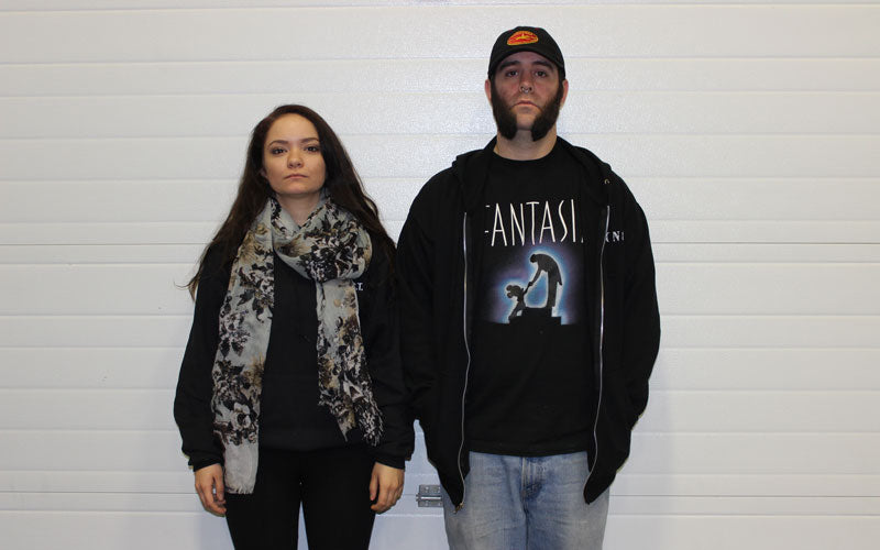 A photo of Death Wish employees Teah and Eric standing in our old warehouse