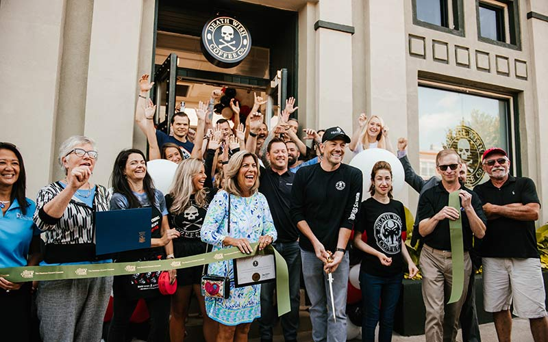 A ribbon cutting ceremony in front of Death Wish Coffee headquarters and retail shop.
