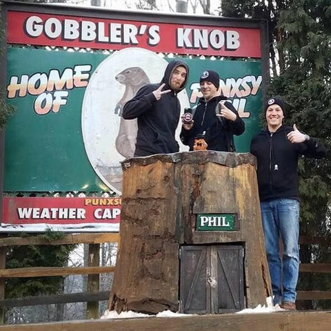 Death Wish employees standing in front of Punxsutawney Phil's home
