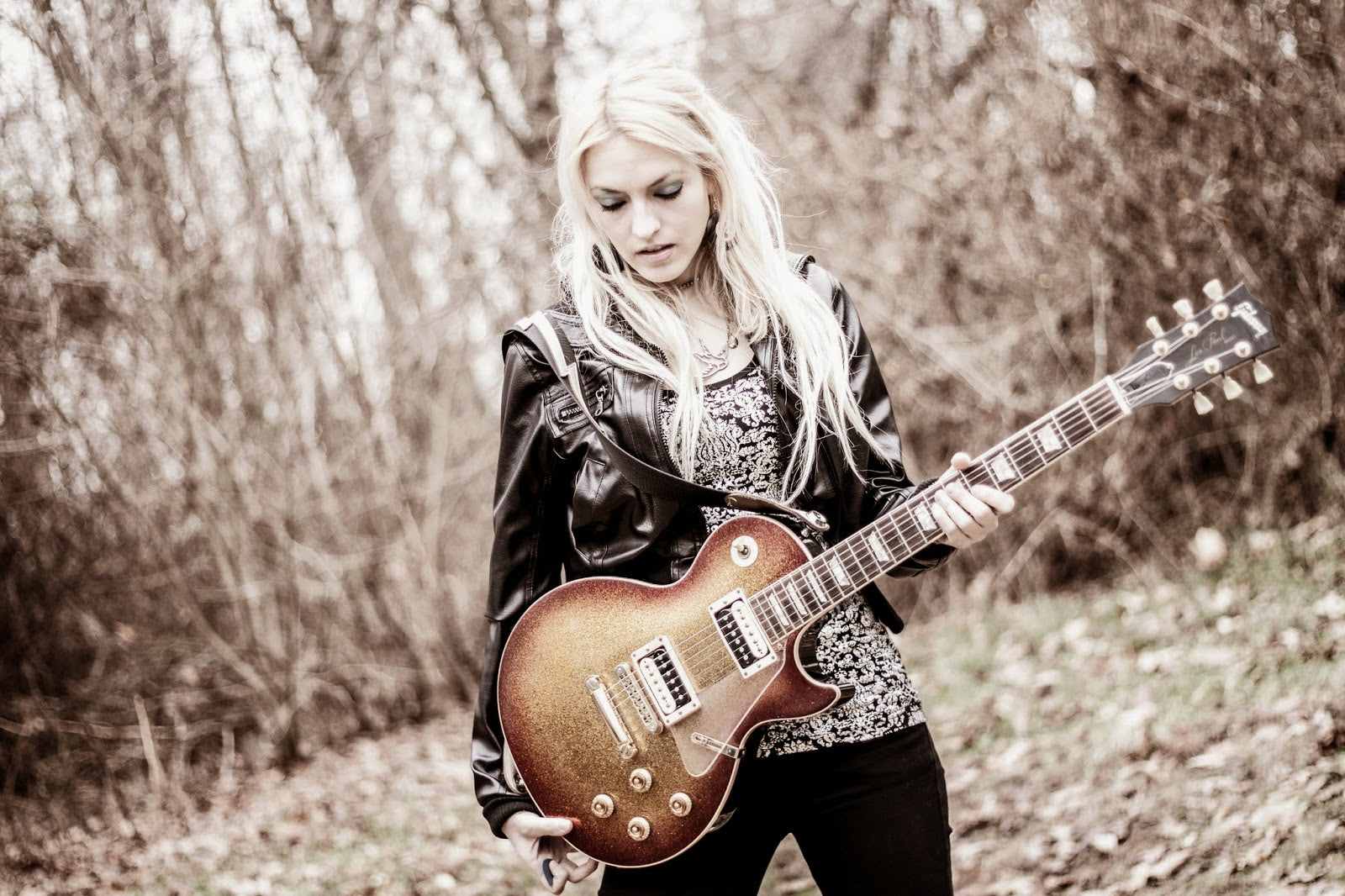 Emily Hastings holding an electric guitar