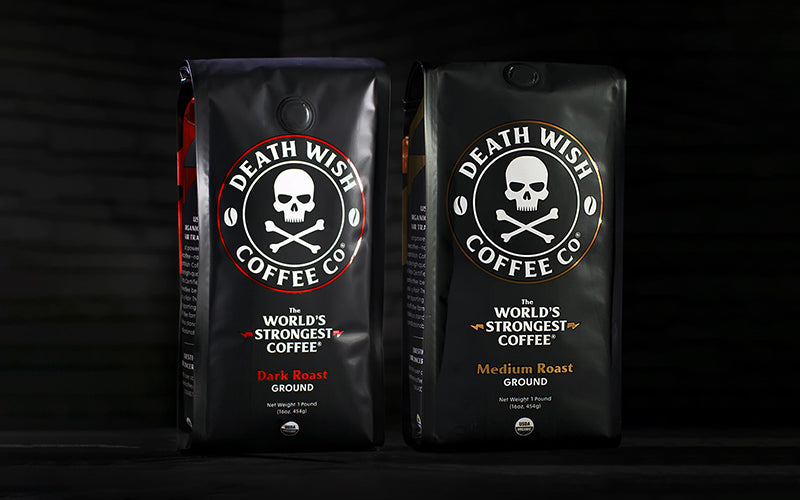 Two bags of Death Wish Coffee with a black background. One bag of Dark Roast, one bag of Medium Roast.