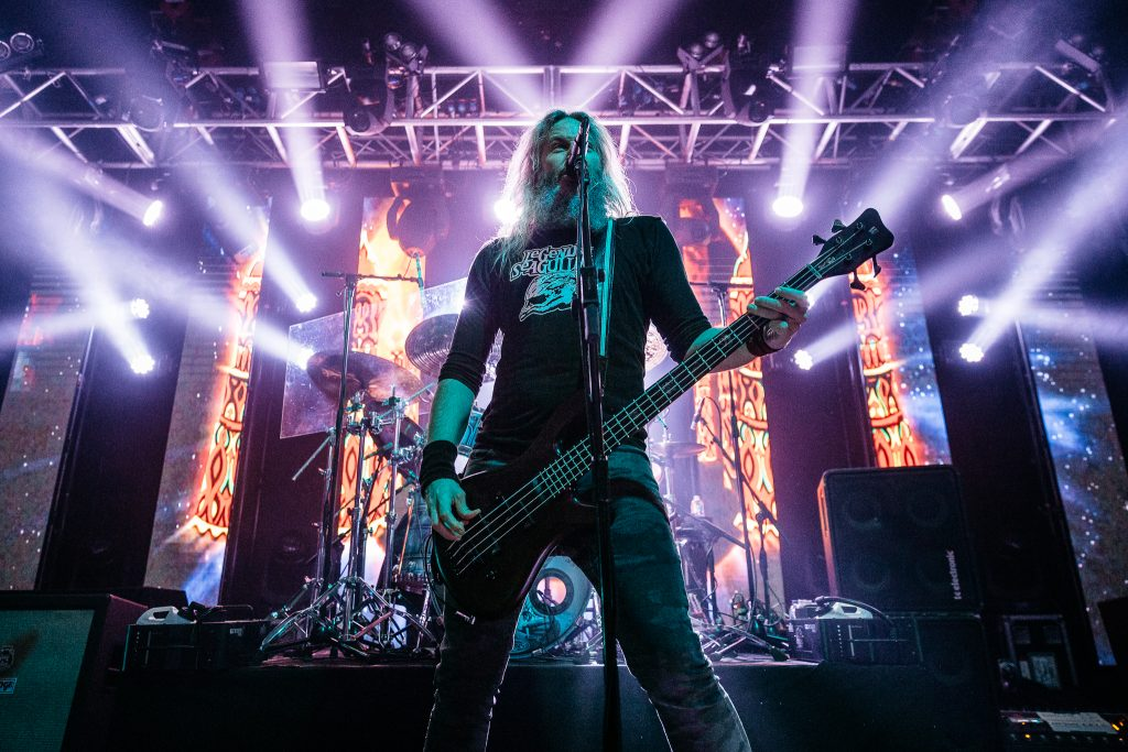 Troy Sanders playing electric bass on stage