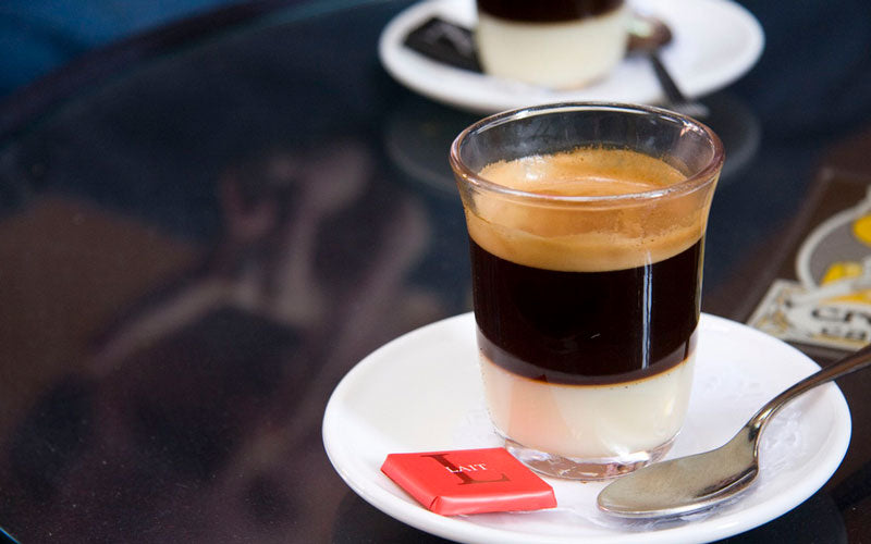 A Spanish coffee called Cafe Bombon, served in a clear glass