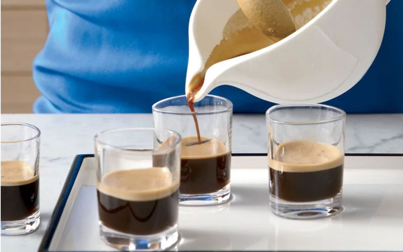 Four glasses of Cafe Cubano on a table