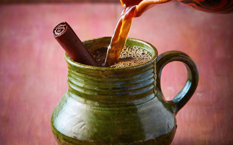 A cup of cafe de olla, a traditional Mexican specialty coffee with cinnamon and piloncillo
