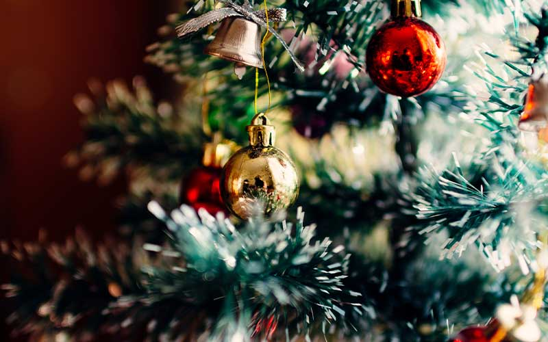 Macro shot of a Christmas tree with ornaments