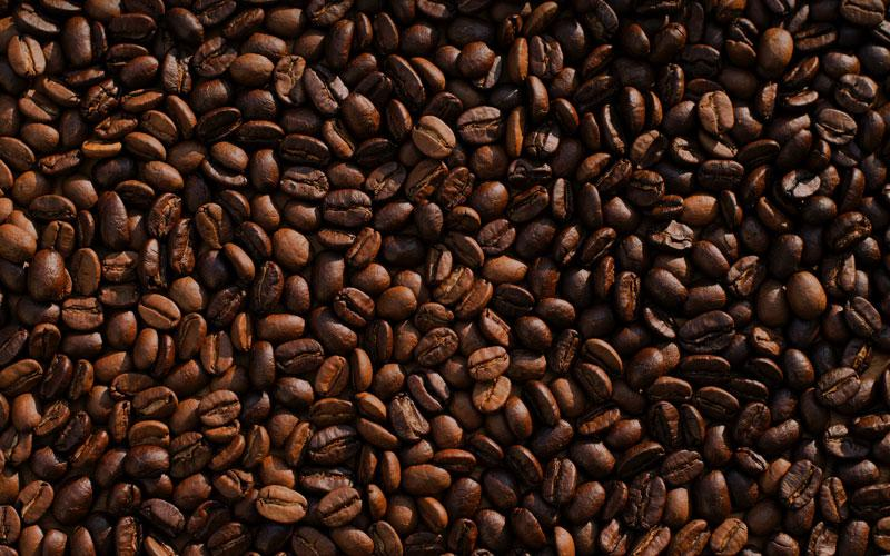 A close-up view of brown roasted coffee beans
