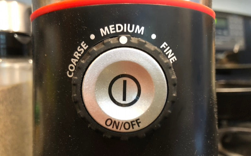 Coffee grinder showing options for course, medium, and fine