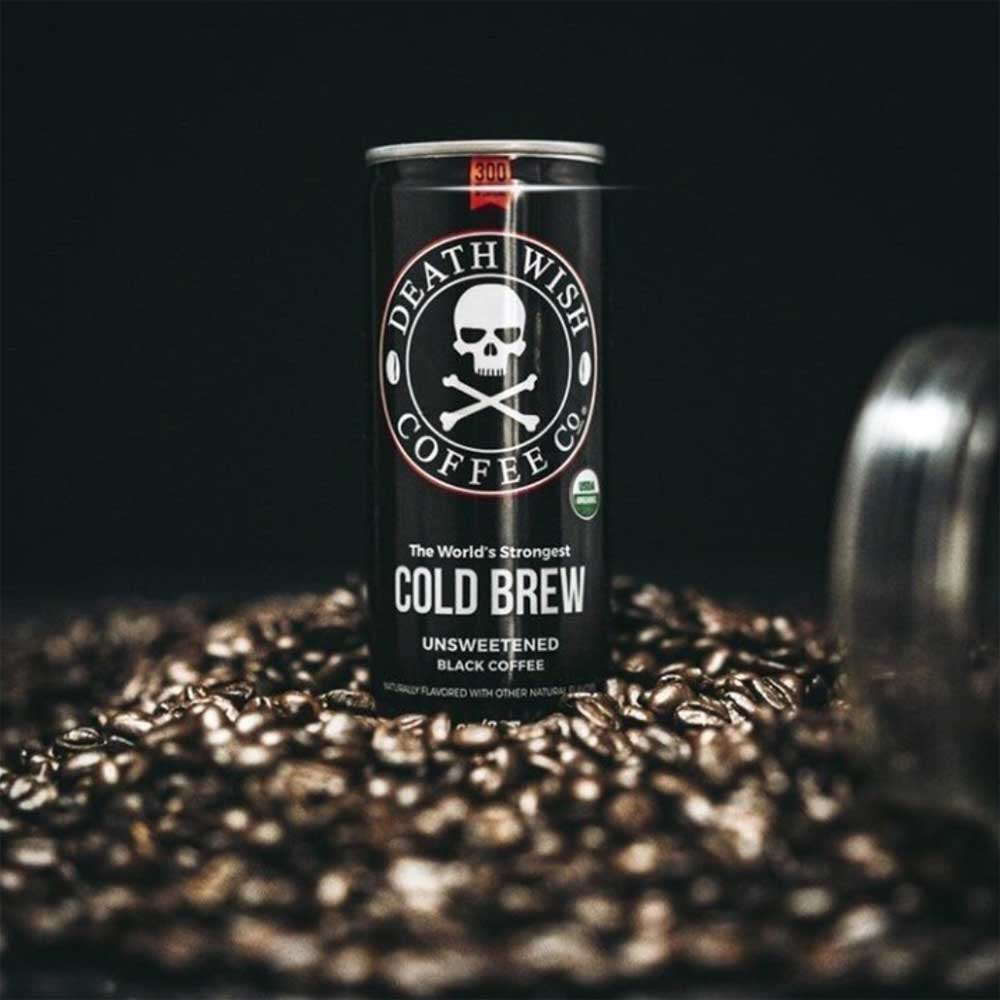 An image of Death Wish Coffee's cold brew on a pile coffee beans.