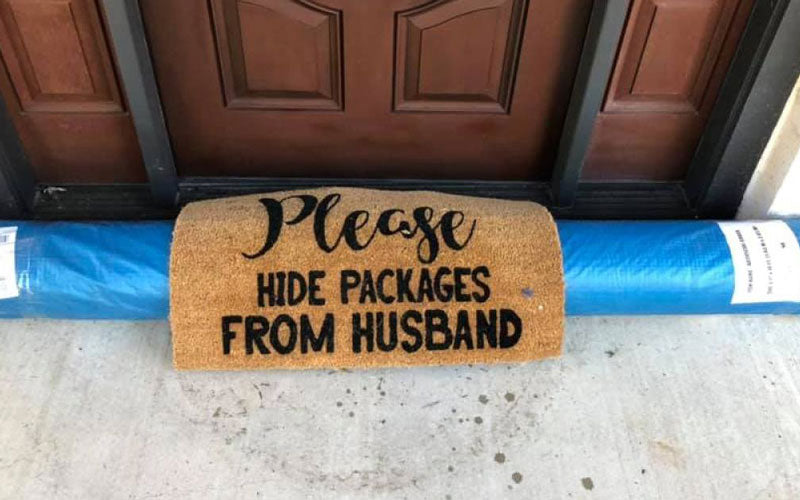"A mailman hid a package underneath a doormat that says ""Please hide packages from husband"""