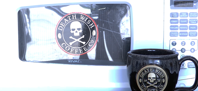 Death Wish mug next to microwave emblazoned with Death Wish logo