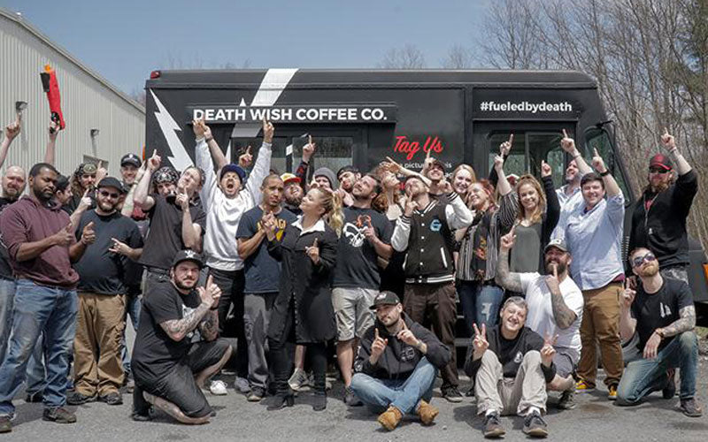 A group photo of the Death Wish Coffee team standing outside our warehouse