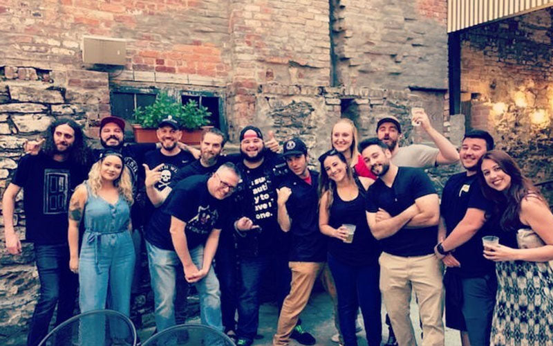 A group of Death Wish employees and community members pose for a photo at a Cold Brew event