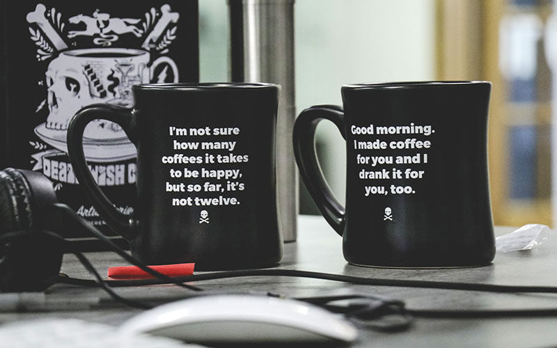 "Death Wish mug that reads: ""I'm not sure how many coffees it takes to be happy, but so far, it's not twelve"""