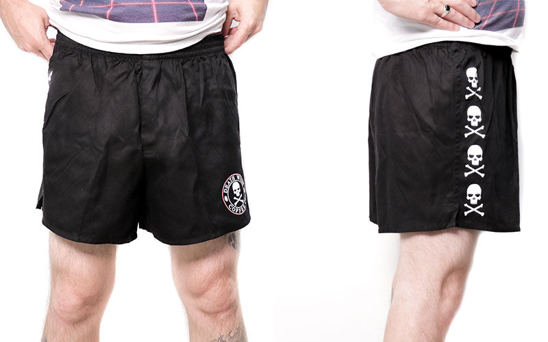 A male pictured from the waist down wearing black Death Wish Coffee boxer shorts