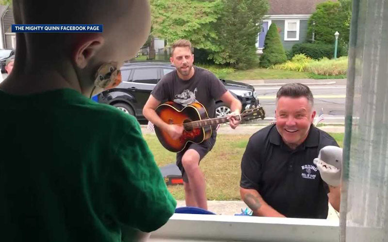 Members of the band Dropkick Murphys perform outside of the home of a three-year-old cancer patient