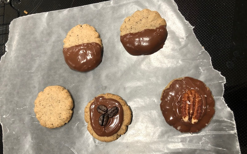 Espresso shortbread cookies plan (left), dipped in chocolate, or with chocolate and pecans or coffee beans on top.