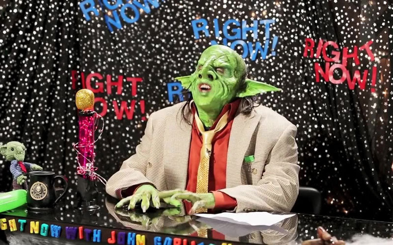 A screenshot of John Goblikon from the metal band Nekrogoblikon in a green goblin costume