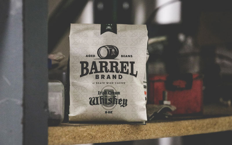 A tan and green bag of Barrel Brand Irish Cream Whiskey Coffee