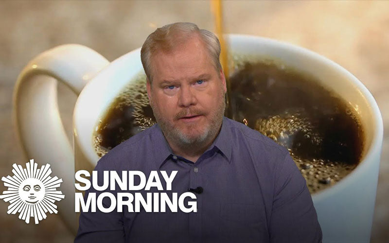 Comedian Jim Gaffigan is pictured in front of a photo of a large cup of coffee with a CBS Sunday Morning logo in white text