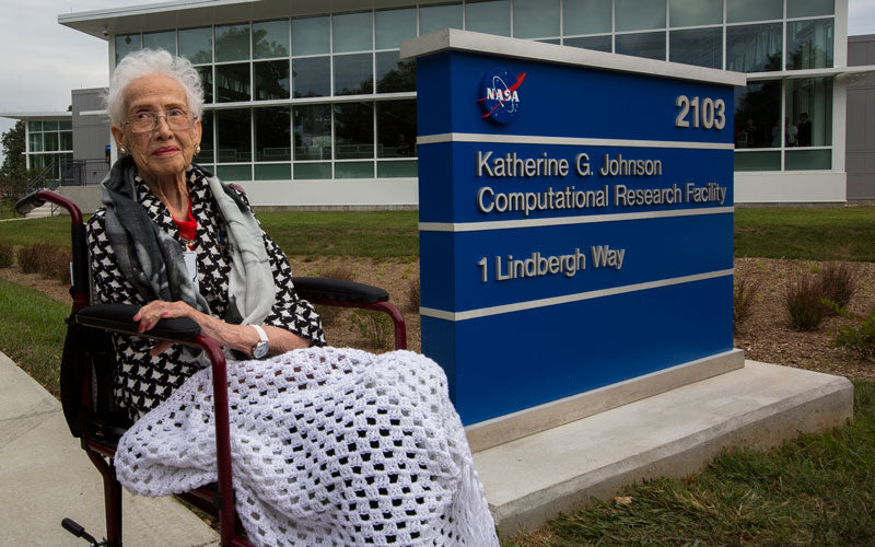 A photo of Katherine Johnson outside of a research facility named after here on NASA's campus