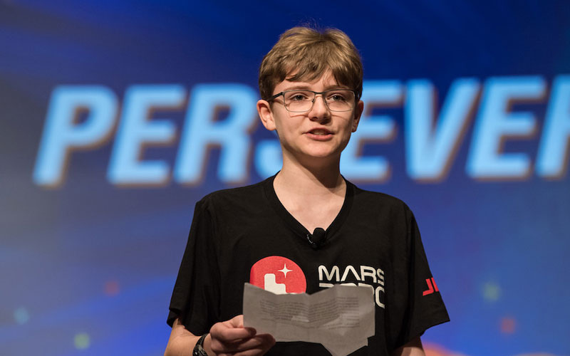 Seventh grader Alexander Mather standing on stage to present his name for the NASA Mars Rover