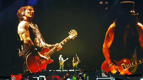 Richard Fortus playing guitar on stage with Slash
