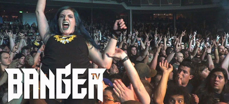 "A girl shown crowd surfing at a concert with white text overlapping it that says ""Banger TV"""