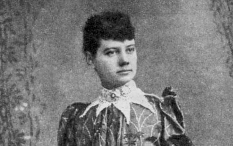A black and white portrait of reporter Nellie Bly taken in the 1890s