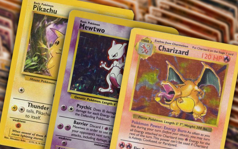 Three Pokemon cards that show Pikachu, Mewtwo, and Charizard