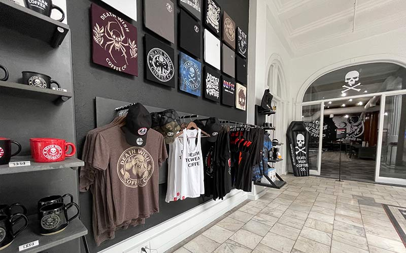 The retail shop at Death Wish Coffee headquarters showcasing some of the exclusive mugs and merch.
