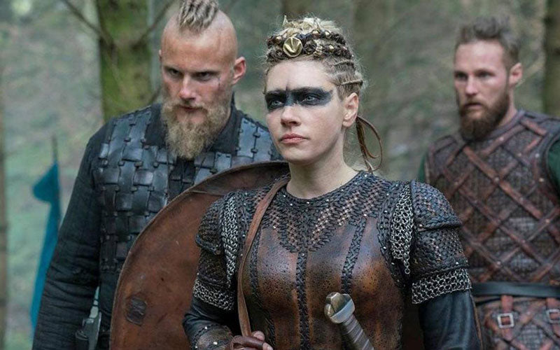 "A screenshot from the TV series ""Vikings"" that shows a female viking and two male vikings"