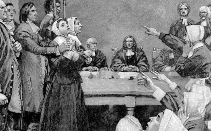 Illustration of a group of Puritan women being accused of