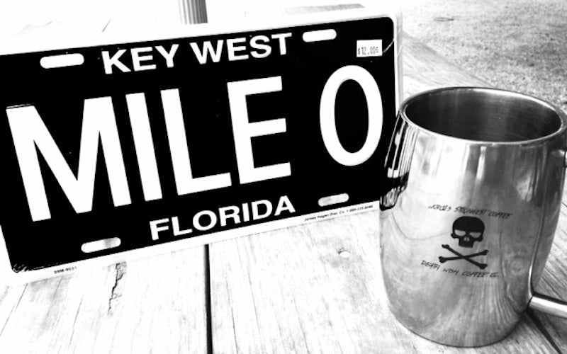 "License plate that reads: ""Key West, Mile 0, Florida"""