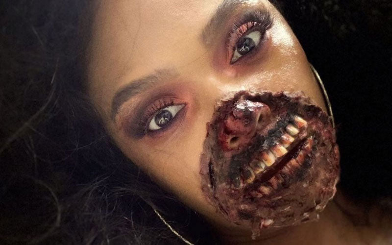 A woman pictured wearing Zombie halloween makeup on her mouth and nose