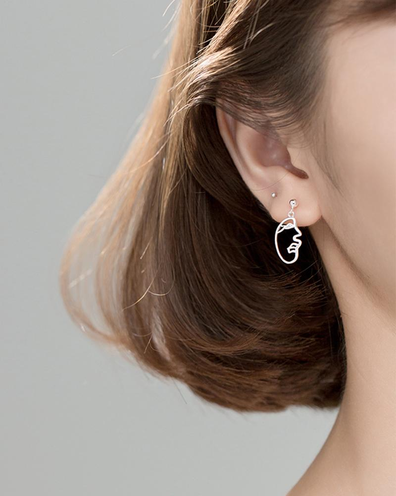 Shop sukoshi Abstract Face Dangle Earrings, profile style on model, sterling jewelry collection