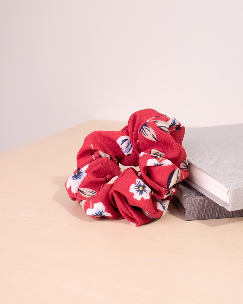 Floral Pansy Pattern Scrunchie in red colour style, displayed on notebooks