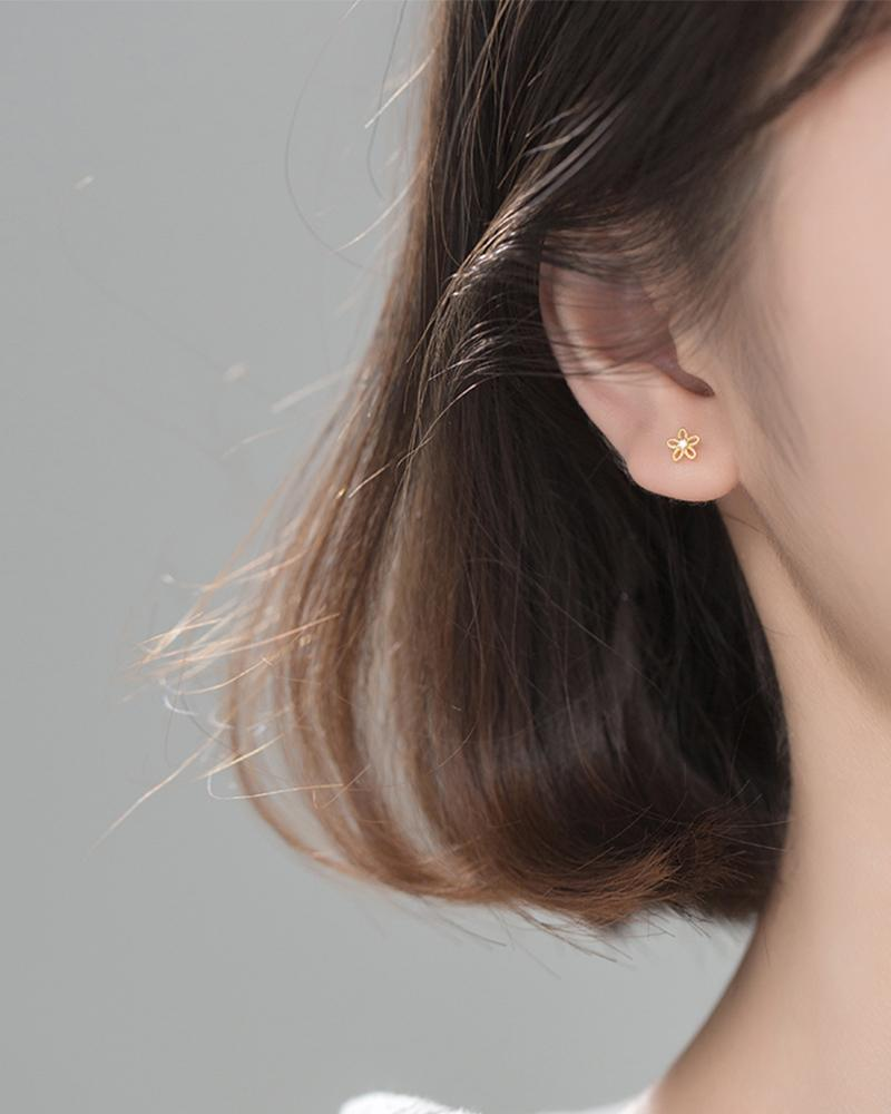 shop sukoshi Flower Wire Mini Stud Earrings in gold on model sterling jewelry collection
